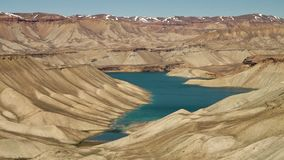 Meandering lake coast with mountains in desert. Band-e Amir Lakes. Band-e Amir National Park, Bamyan Province, Afghanistan. Wide shot stock video