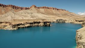 Meandering lake coastline in lake basin. Band-e Amir Lakes. Band-e Amir National Park, Bamyan Province, Afghanistan. Pan right. Pan left.  wide shot stock footage