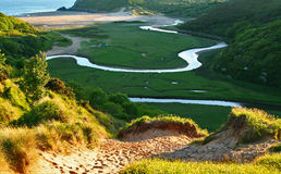 Meandering river. The river at three cliff bay in the gower peninsula, south wales UK royalty free stock images