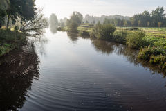 Meandering river in early morning light Stock Photo