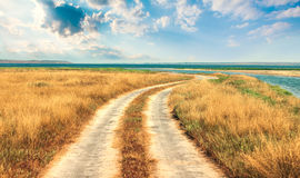 Meandering road to sea Royalty Free Stock Photos