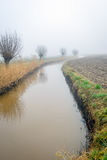 Meandering stream in a rural landscape Stock Photography