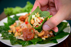 Meang. Pork and  herbs wrapped in betel leaf Royalty Free Stock Images