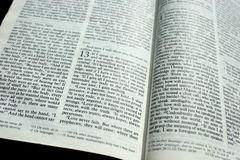 The Meaning of Love. The Bible opened to I Corinthians 13 (readable), the passage about love Stock Photos
