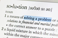 Meaning of solution. In online dictionary and hilight at solving a problem word royalty free stock images