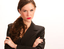 Serious Woman Means Business Arms Crossed. An Attractive Brunette Businesswoman arms crossed and serious stock images