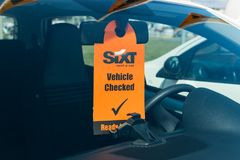 Corfu, Greece - July, 2018: Vehicle Checked sign on Sixt rental car royalty free stock photography