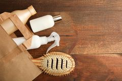 Means for care of hair. In a package on a wooden background. Top view stock photography