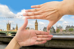 Means frame over Big Ben. Close up of hands symbol that means frame over Big Ben and Houses of Parliament in London Royalty Free Stock Photography