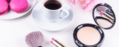 Panoramic mocap with a cup of coffee, Cake, powder and lipstick, female morning background. Means for a morning make-up - a panoramic mocap with a cup of coffee royalty free stock photos