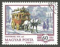 Means of transport, Omnibuses. Hungary - stamp 1977, Color edition, Means of transport, Omnibuses, Series History of the Coach, Omnibus on boulevard Royalty Free Stock Image