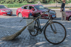 Means for work of the Chinese yard keeper. The vehicle and instruments of labor for work of the Chinese yard keeper Royalty Free Stock Photo