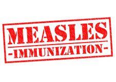 MEASLES IMMUNIZATION. Red Rubber Stamp over a white background Royalty Free Stock Photo