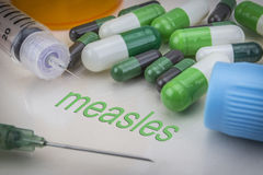 Measles, medicines and syringes as concept stock photos