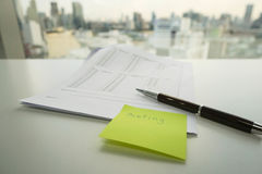 Meassage note of meeting on green postit Stock Photography