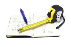 Measue notes. Notebook pen and measure tape Royalty Free Stock Photography