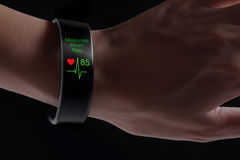 Measurate heart rate application with smart wristband. Stock Image