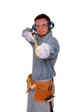 Measure 4. Young carpenter using tape measure, smiling Stock Images