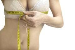 Measure. Beautiful young woman with measure tape around waist Stock Image