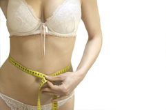 Measure. Beautiful young woman with measure tape around waist Stock Images