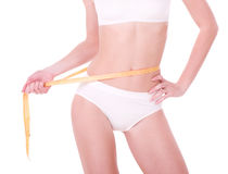 Measure on beautiful woman body Royalty Free Stock Photo