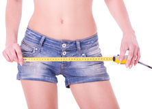 Measure on beautiful woman shorts Stock Photo