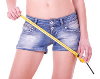 Measure on beautiful woman shorts Stock Photography