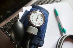 Measure blood pressure Royalty Free Stock Photo