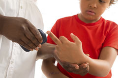 Measure child glucose level blood test diabetes little boy using Stock Image