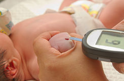 Measure child glucose level blood test diabetes Stock Photos