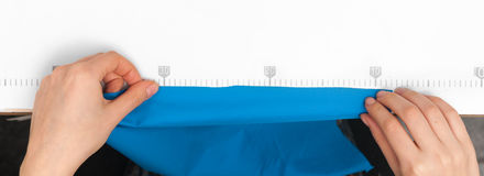 Measure the cloth on the line drawn Stock Photos