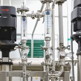Measure equipment, pipe and pump on pharmaceutical industry Stock Photos