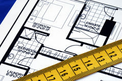 Measure the floorplan with a  measuring tape Stock Photos
