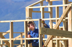 Measure the framing. Builder measures and lines up framework on building Royalty Free Stock Image