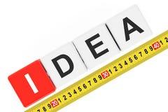 Measure Idea Concept. Idea Cubes with Measuring Tape Stock Photo