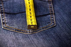 Measure line tape roll on blue denim. Stock Images