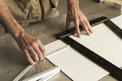 Measure and mark. Close-up of hands of a joinery while measuring and marking the wood that will work stock photos
