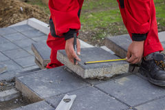 Measure and marking pavement stone before cutting 2 Royalty Free Stock Image