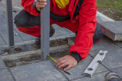 Measure and marking pavement stone before cutting 3 Royalty Free Stock Photo