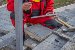Measure and marking pavement stone before cutting 5 Stock Photo