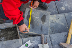 Measure and marking pavement stone before cutting Royalty Free Stock Photography