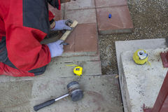 Measure and marking pavings stones 2. Measure and marking pavings stones before cutting Stock Image