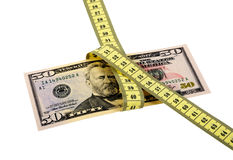 Measure Money. Measuring tape over money, budgeting, measure money, tight budget Stock Image