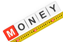 Measure Money Concept. Money Cubes with Measuring Tape Royalty Free Stock Photo