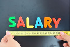 Measure salary concept in a company Royalty Free Stock Photo