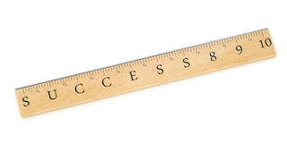 Measure Success. A wooden ruler concept used to measure success over white background Stock Image