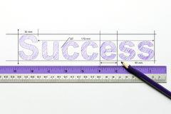 Measure success concept. Measuring the word success using ruler and pencil Stock Photography
