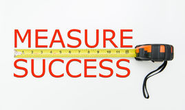 Measure success. Measure of success conceptual using measuring tape Stock Image