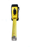 Measure tape. Metal measure tape in yellow case Royalty Free Stock Photography