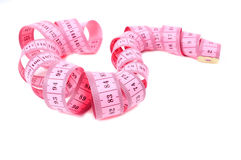 Measure tape. Beautiful rose meter on white background Stock Photos